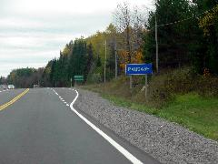 Puadash Boundary Sign on Highway 28
