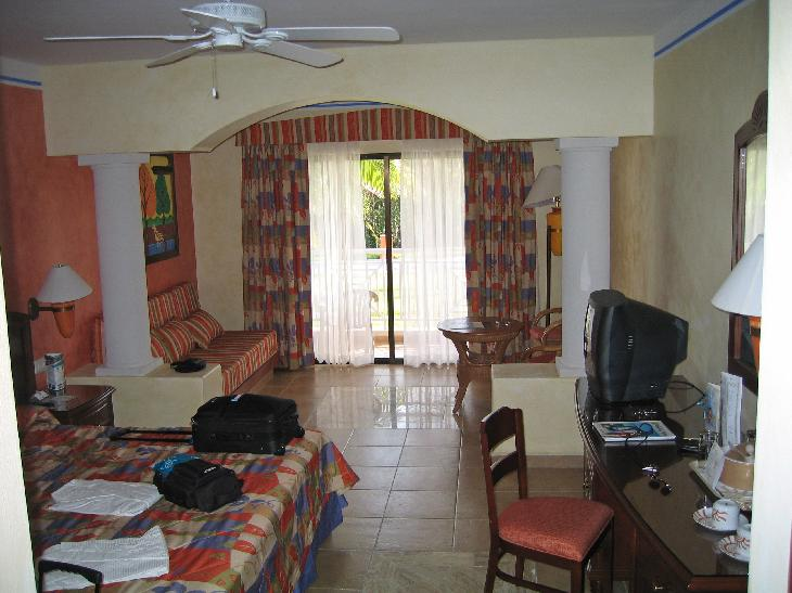 View inside of room at Bahia Principe Coba in Mayan Riveria in Mexico.  This is the view of the bed, sitting area and patio door.