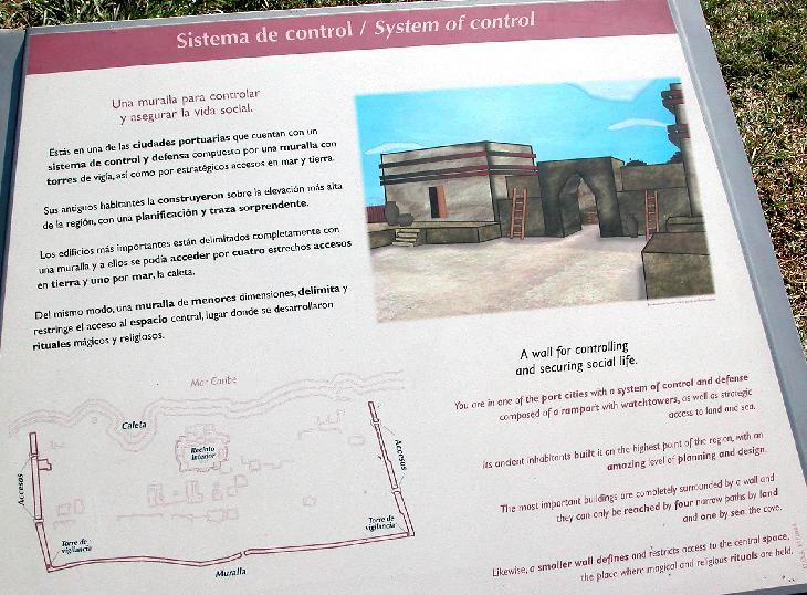 An information sign at the Tulum Ruins, describing the system of control and defense.  The Tulum Ruins are located in the Mayan Riviera of Mexico.