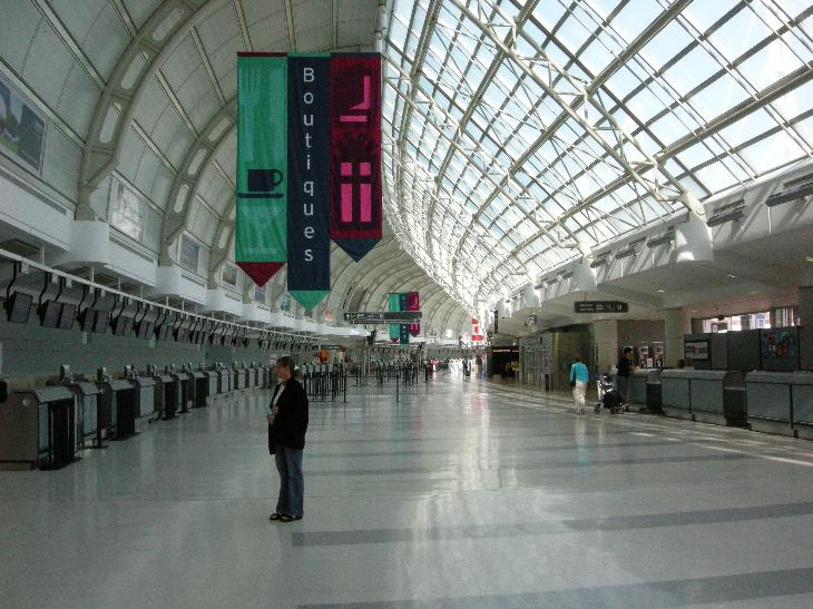 A view of an almost empty Departures Ticketing lobby at Toronto Pearson International Airport in Canada.