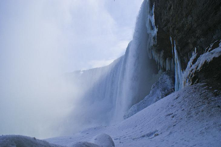 Photo of Niagara Falls from the tunnel underneath the Falls.  Taken in the winter, February.
