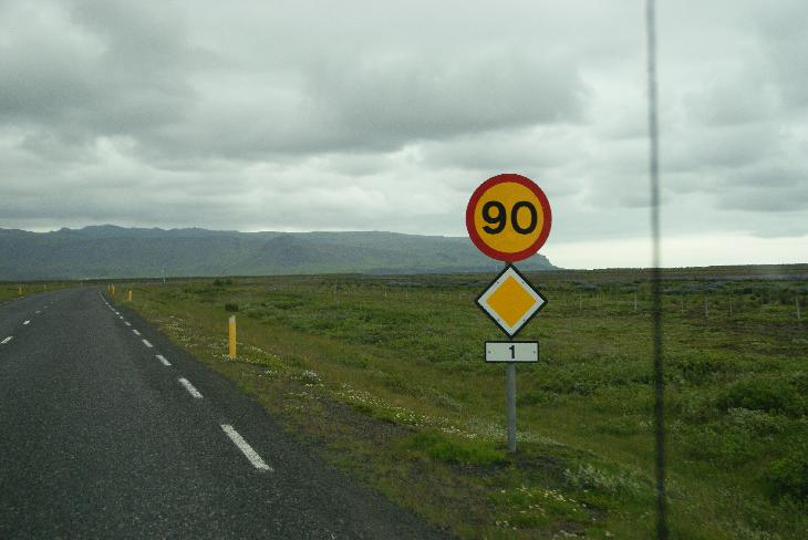 Road sign on Highway 1 in Iceland, showing the 90 km/h speed limit.