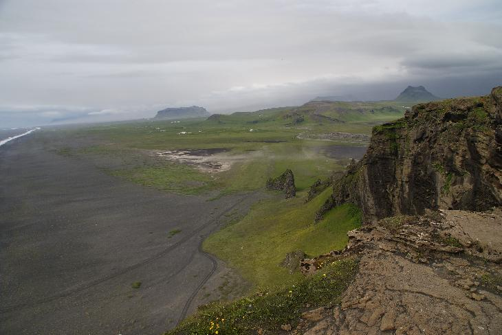 Photo of a black sand beach near Dyrhólaey in Iceland. Just around the corner is Vik. Photo taken from Dyrhólaey.