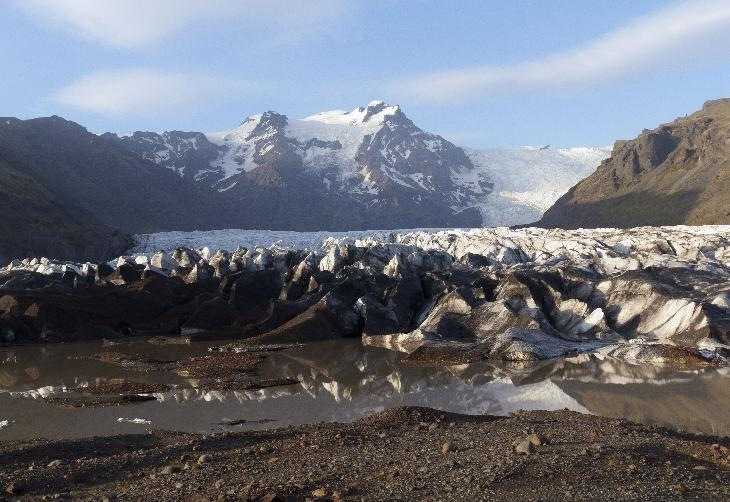 Photo of water in front of melting Svinafellsjökull Glacier tongue in Icleand.
