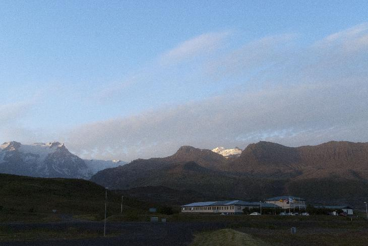 Photo of Fosshotel Skaftafell in Iceland with mountain and glacial backdrop.
