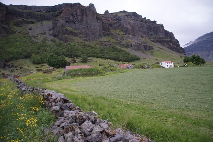 Photo of the house, barns and church, of the Nupsstadur farm in Iceland.