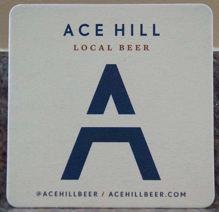 A beer coaster from Ace Hill Beer Company.  Used in 2017.  There are multiple versions, this one is white, another one is blue.  Both sides are the same.