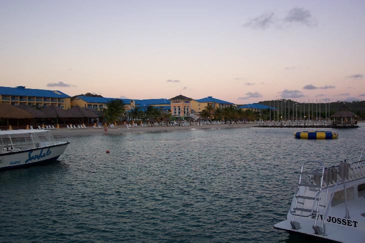 Photo of beach at Sandals Grande Lucian Resort and Spa.  Taken during from the pier right before sunset.