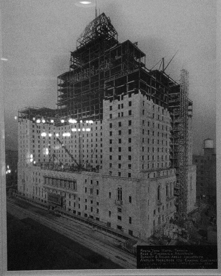 Photo of Fairmont Royal Hotel under construction in 1928.  Original photo taken October 18, 1928.  Previous hotel on site was the Queens Hotel, which was demolished September 1927.  Display on Mezzanine at the Royal York.