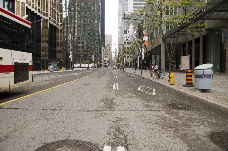 Photo of Bay Street in Toronto.  Take at the intersection of Bay and Front Streets.  Old Toronto City Hall can be seen in the distance at Queen Street.