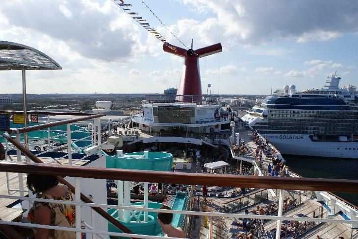 Photo of the Carnival Freedom giant television screen and main pool, while docked at Fort Lauderdale Florida.