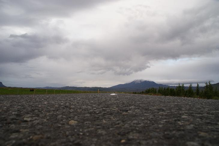 A ground view photo of Mount Hekla as seen from the surface or Road 26 in Iceland.