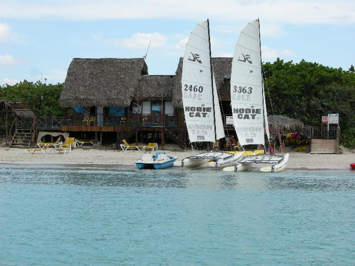 Photo of the Beach Activity Centre at Sandals Royal Hicacos.  Taken from a pedal boat while in the ocean.