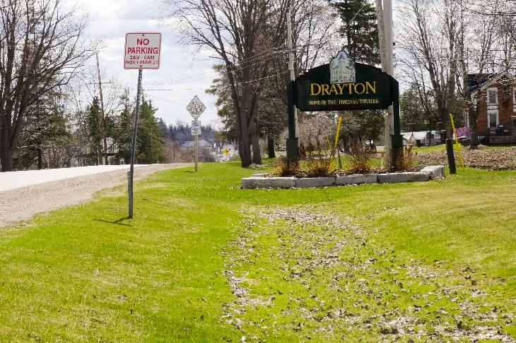 The welcome sign for the community of Drayton Ontario heading south on Wellington street, which is also known as County Road 11.
