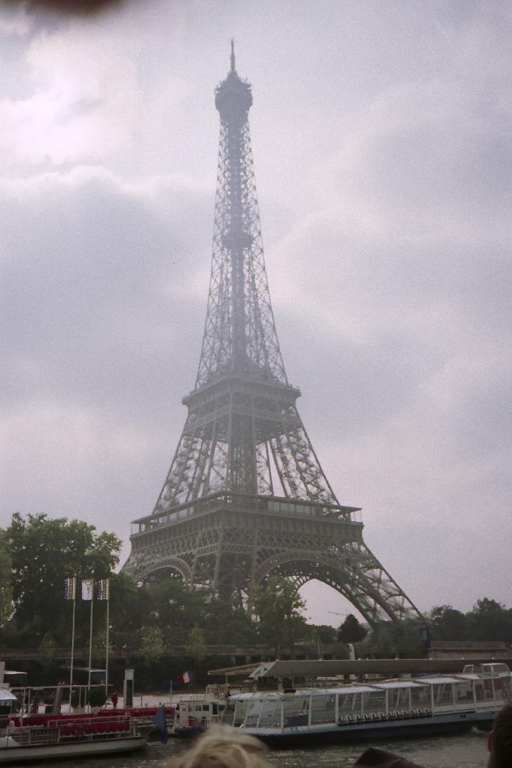 View of Eiffel Tower during a Seine river boat tour.  Taken in 1996.  Scanned from a negative.