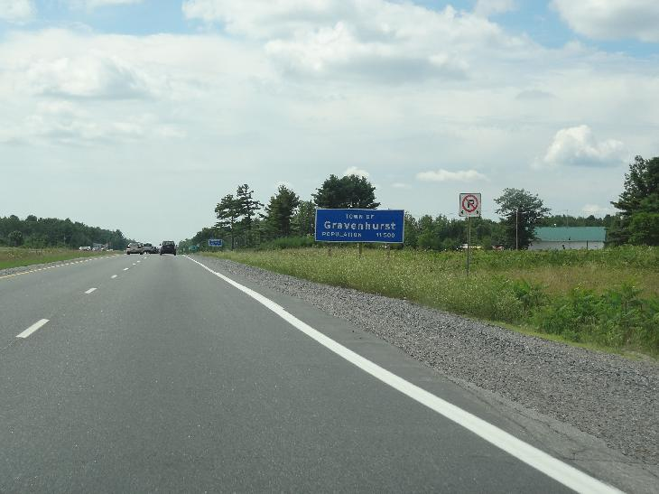 Population sign on Gravenhurst Ontario, travelling south on Highway 11.
