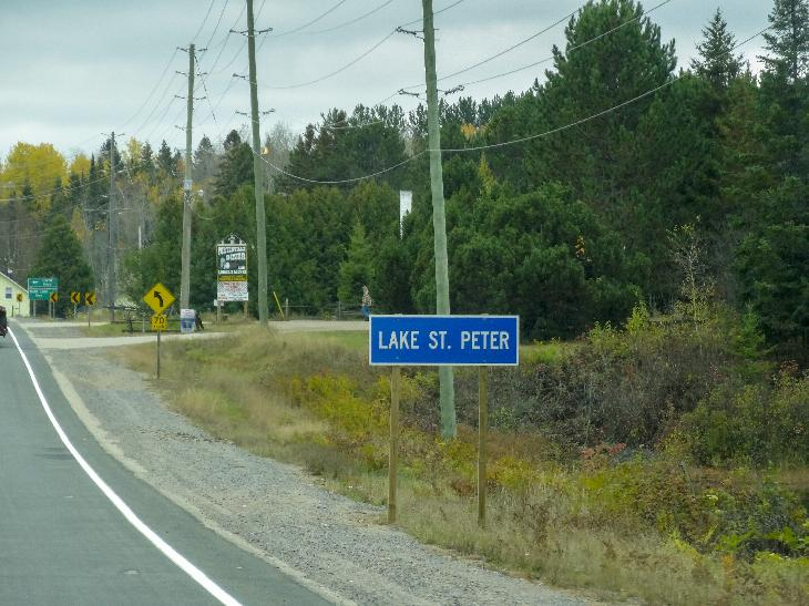 The town limits sign for the village of Late St. Peter.  Located on Highway 127, just north of Mink Lake road.  Located in th township of Hastings Highlands.