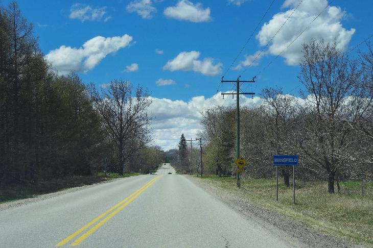 The town limits sign entering Mansfield Ontario.  Travelling west along County Road 17.  Mansfield is located in the County of Dufferin.