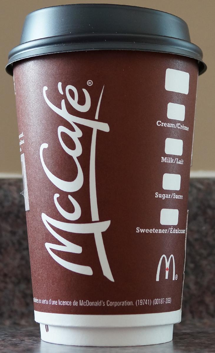 The front side of the standard McDonalds medium coffee cup in 2017. Purchased in Ontario.