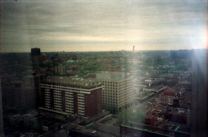 Taken from a Montreal hotel.  Shows the Montreal cityscape and Olympic Stadium in the distance.  Was scanned from a negative.