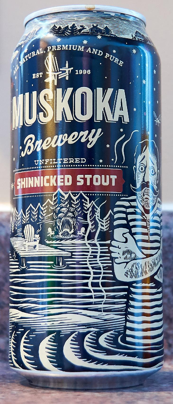 The front view of a Shinnicked Stout beer can.  Brewed by Muskoka Brewery.  Tasting notes are: Velvety smooth with higher carbonation for a lighter mouthfeel. Dark roasted chocolate flavours complement strong coffee notes, present from roasted coffee additions.