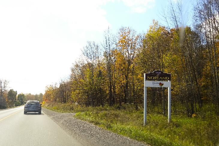 Photo of the town limits sign for Norland Ontario.  Located southbound along County Road 45.  Located in city of Kawartha Lakes, formerly Victoria County.