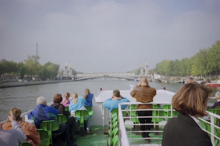 While on a tourist cruise along the Seine River.  Approaching Pont Alexandra, with the Eiffel Tower in the distance.  Scanned from a negative.