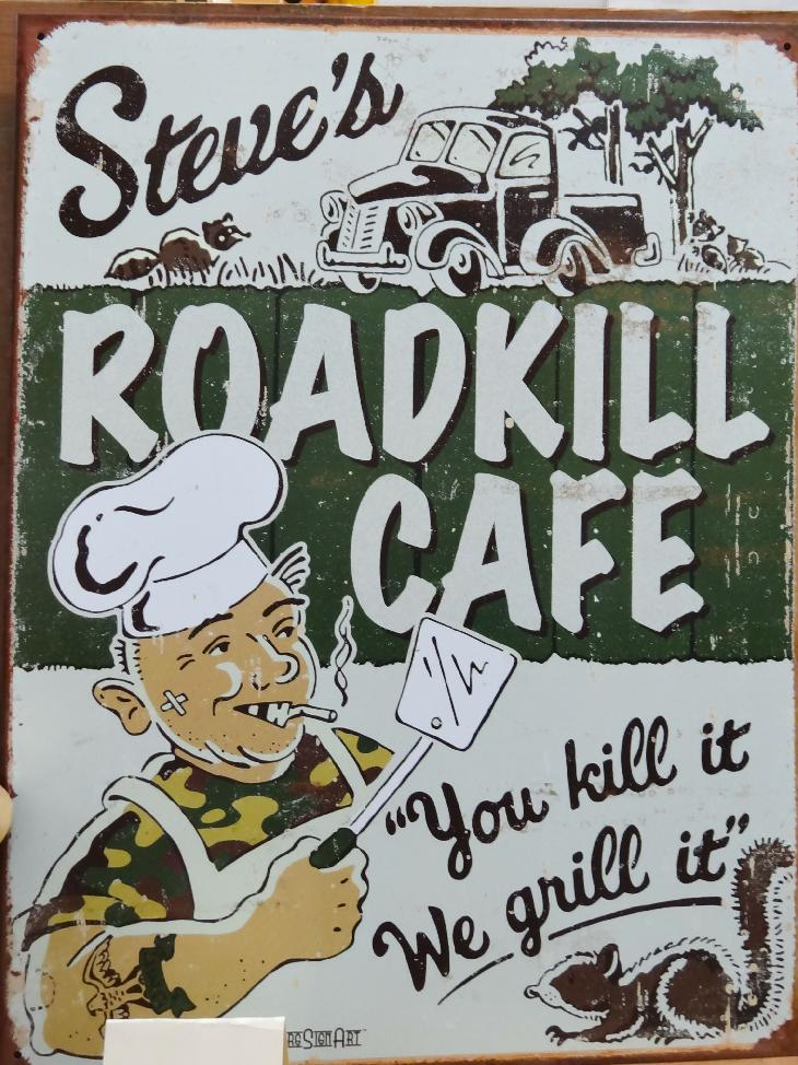 Photo of steel sign in store for the RoadKill Café!