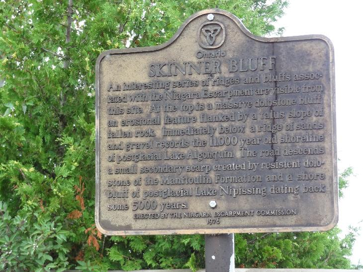 Sign describing the history of Skinner Bluff.  Located near Wiarton Ontario.  Describes its origins related to Lake Algonquin.