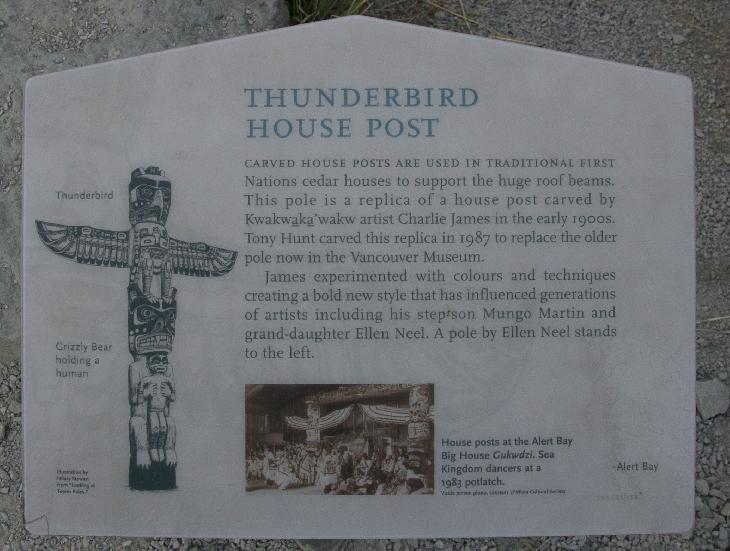 replica of the Thunderbird House Post totem pole information sign.  Located within Stanley Park in Vancouver.