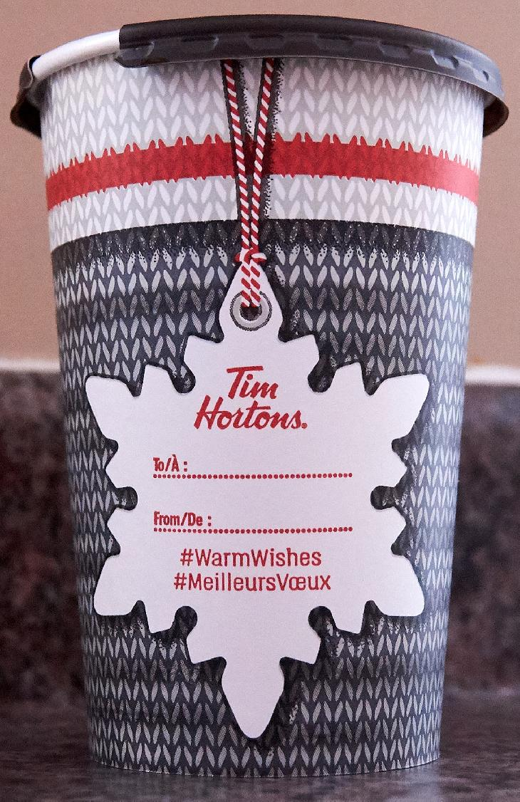 The back of the Tim Hortons large Christmas 2017 coffee cup. This is the Canadian version, found in Ontario.