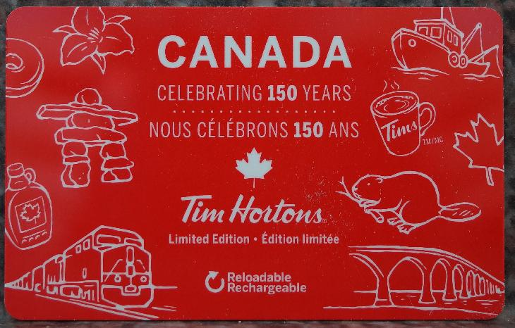 A photo of the Tim Hortons gift card, which salutes Canada's 150th anniversary.  Includes various icons of Canada.