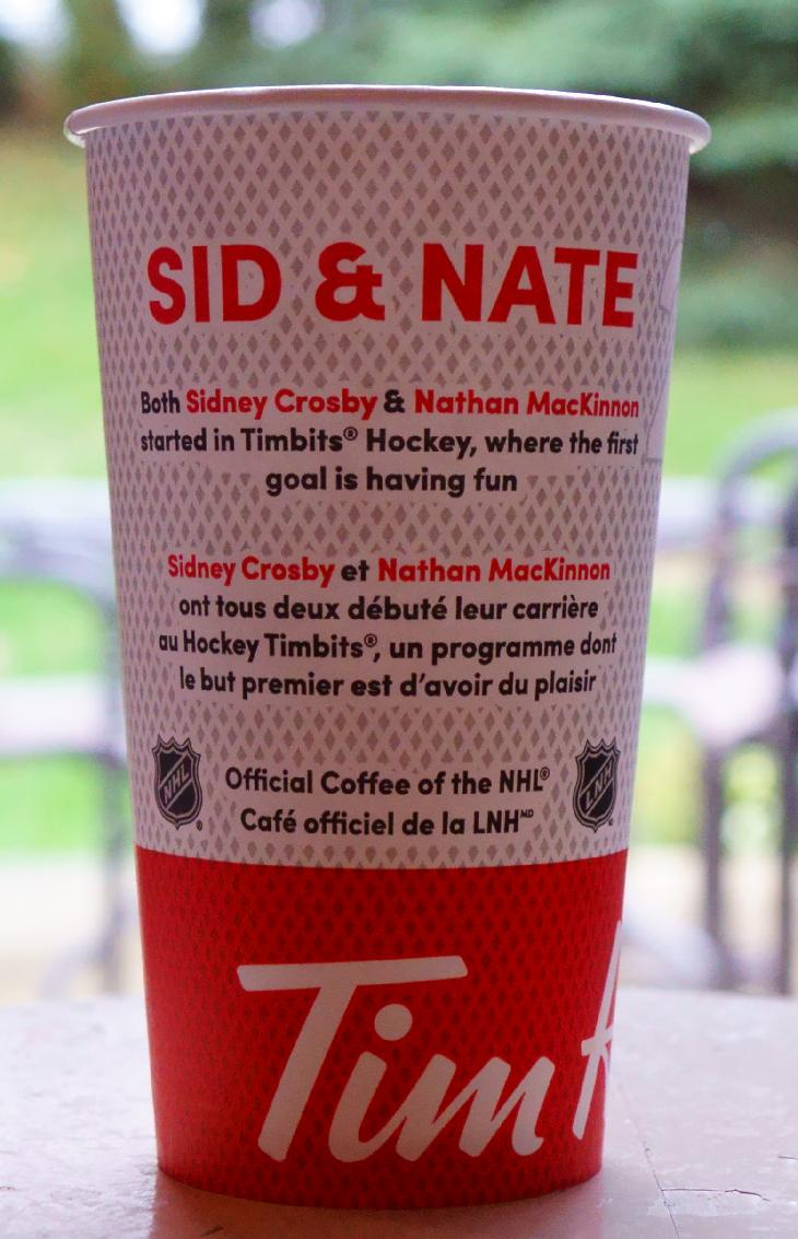 A special Tim Hortons coffee cup with images and Sidney Crosby and Nathan MacKinnon on the front of the cup.  This cup was part of the fall drive for Upper Deck Hockey Cards from Tim Hortons.