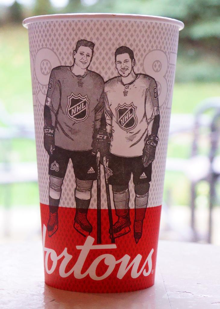 A special Tim Hortons coffee cup with images and Sidney Crosby and Nathan MacKinnon on the front of the cup.  This cup was part of the fall drive for Upper Deck Hockey Cards from Tim Hortons.  this particular image is the front of the cup.