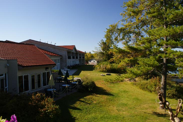 A view of lawn and guest rooms at the Inn at Christie's Mill in Port Severn.