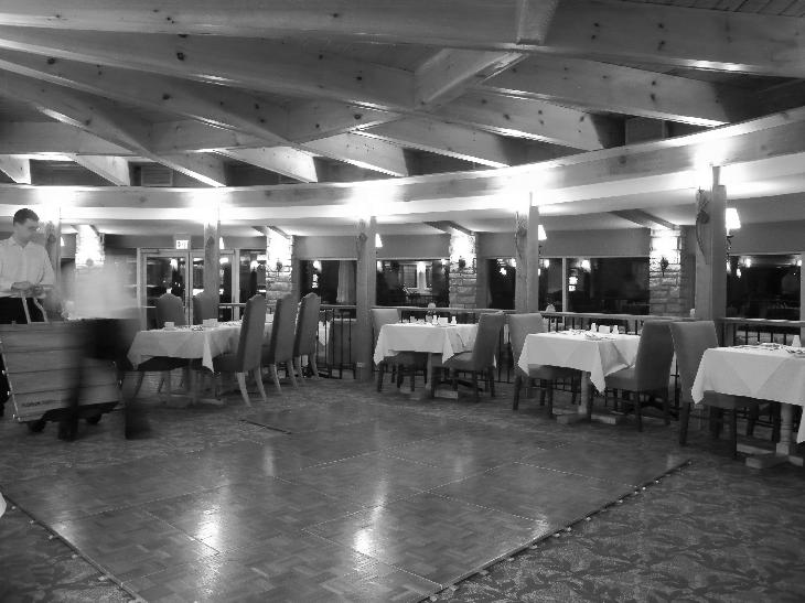 A black and white photo of the dining room in the Inn at Christie's Mill