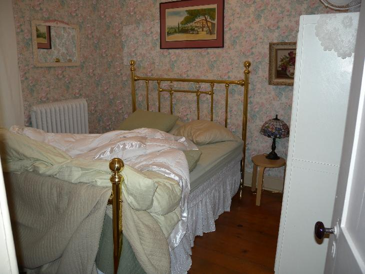 The upstairs bedroom in the Servant's Quarters at the Drew House Bed and Breakfast