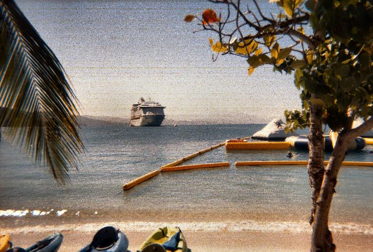 A view of the Explorer of the Seas cruise shipped, anchored off the shore of Labadee Haiti.  Scanned from a negative taken with a displosable camera.