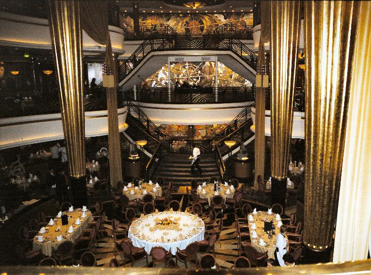 View of the main dining room in the Royal Caribbean cruise ship the Explorer of the Seas.  Taken at the entrance to the room.  Scanned from a negative.