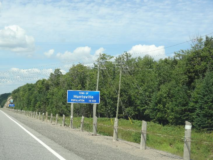 Huntsville Population Sign while travelling on Highway 11 North, 19km south of Huntsville city centre.