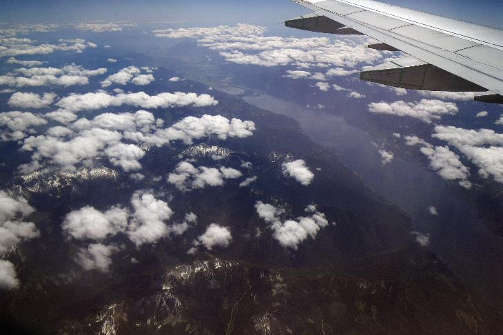 Arial view of Kootenay Lake and Duck Lake from airplane while flying over British Columbia.