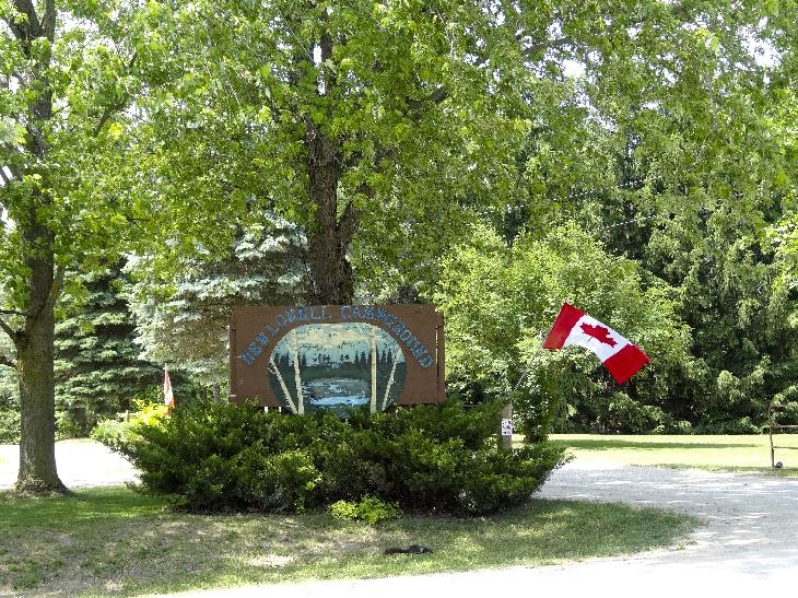 Main entrance sign at New Lowell Campground in New Lowell Ontario.