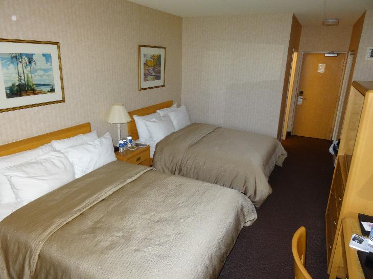 Room in Nottawasaga Inn Resort and Conference Centre, near Alliston Ontario.  View of two queen beds and door to hallway.