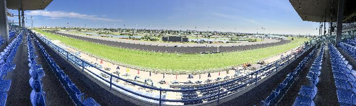 Woodbine racetrack in Toronto Canada. This panorama is taken near the finish line.  The curved appearance is from the nature of the panorama.