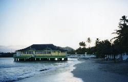 View of the Sandals Halcyon Beach Resort at sunset.  The Pier restaurant is also shown.