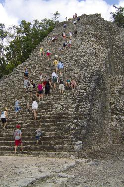 Climbing the Nohoch Mul Pyramid in Coba Mexico