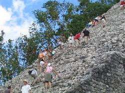 Climbers of the Nohoch Mul Pyramid Coba Mexico.  Located in the Mayan Ruins of Coba, Mexico.