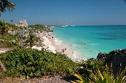 This is the picturesque sandy beach at the Tulum Ruins.  The ruins are located in the Mayan Riviera of Mexico.  The Tulum Castle can be seen above the beach.