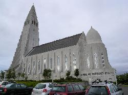 Hallgrimskirkja (Hallgrim's Church) in Reykjavik.  At 74.5 metres (244 ft) high, it is the largest church in Iceland and among the tallest structures in Iceland.  Designed to resemble the basalt lava flows of Iceland's landscape.