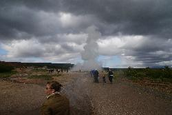 Photo of the Strokkur geyser erupting.  It is located at the same site as the Great Geysir.